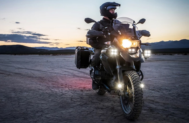 Picture of a motorcycle in the dark with many lights on
